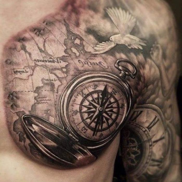 eine weiße taube, eine große weltkarte und ein großer schwarzer kompass - idee für einen compass tattoo für mann
