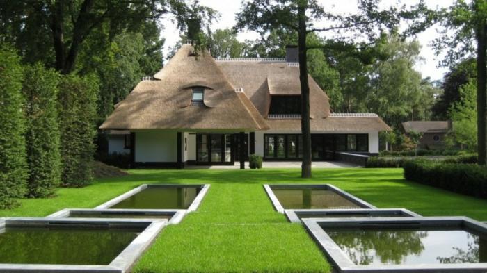 ein bildschönes Haus in Sylt mit einem modenen minimalistischen Vorgarten