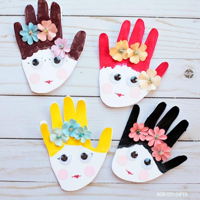 Frauengesichter aus Handabdrücken, aus Papier schneiden, Wackelaugen und Papierblumen kleben