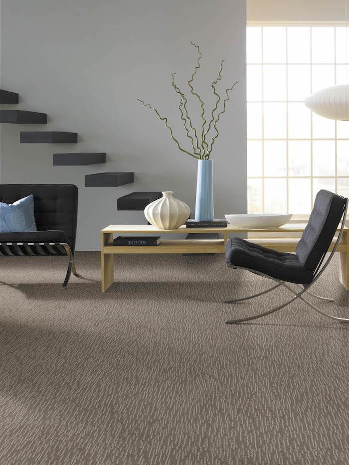 modernes Wohnzimmer mit Designer Möbel und Designer Fußboden aus Marmor in brauner Farbe