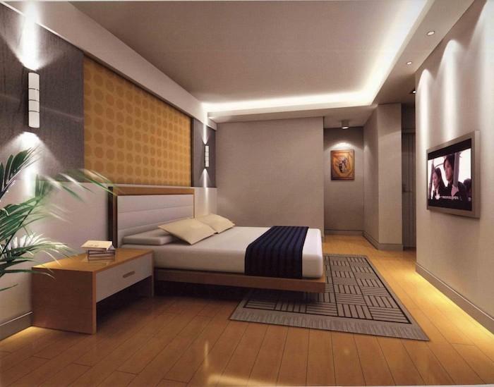 schlafzimmer in gelb und grau, bett, fernseher, teppich