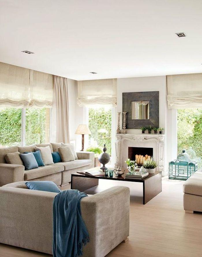 feng shui wohnzimmer, kamin, kaffeetisch aus holz, graues sofa