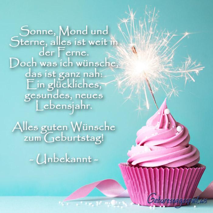 Cupcake mit Bengallicht und viel Zuckerguss, gute Wünsche zum Geburtstag