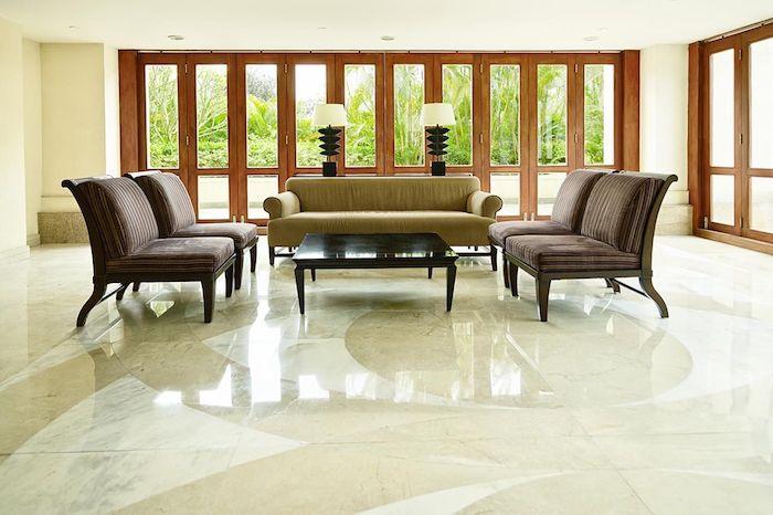 Design Fußboden Fliesen wie Augen Muster große Fliesen im Wohnzimmer vier Sessel