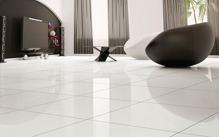 ein modernes Wohnzimmer mit Designer Möbel und Design Boden in weißer Farbe