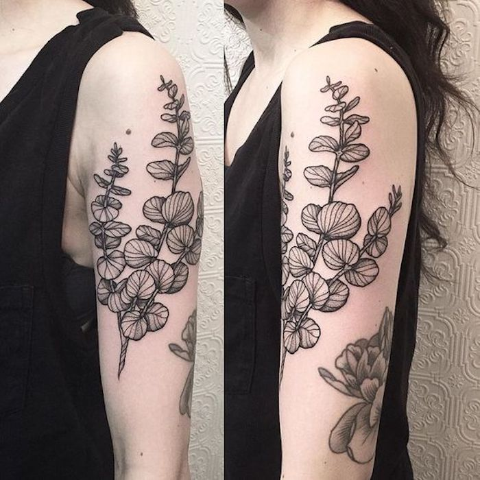 eine schöne Blume mit grünen Blättern am Oberarm Tattoo realistic - Tattoo Stile