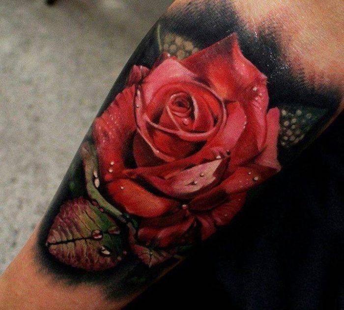tattoo vorschläge, bunte tätowirung mit rose-motiv am unterarm