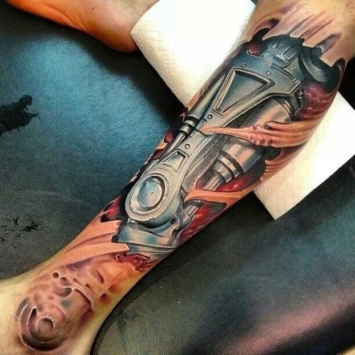 tattoo vorlagen männer, biomechanische tätowierug am bein