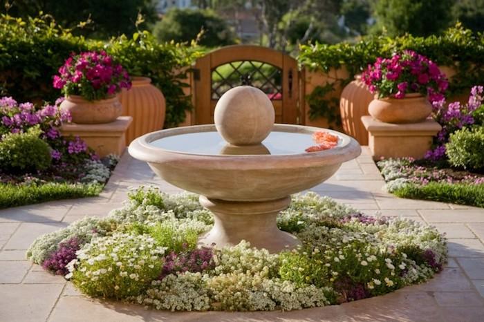 gartengestaltung bilder, vordergarten mit fontäne und vielen blumen