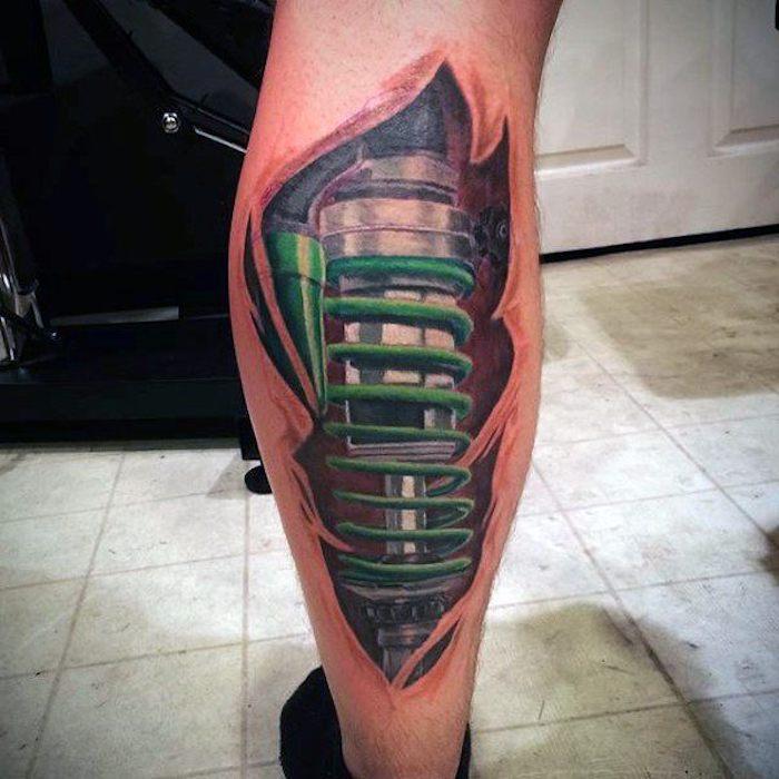 männer tattoos, biomechanische tätowierung am bein