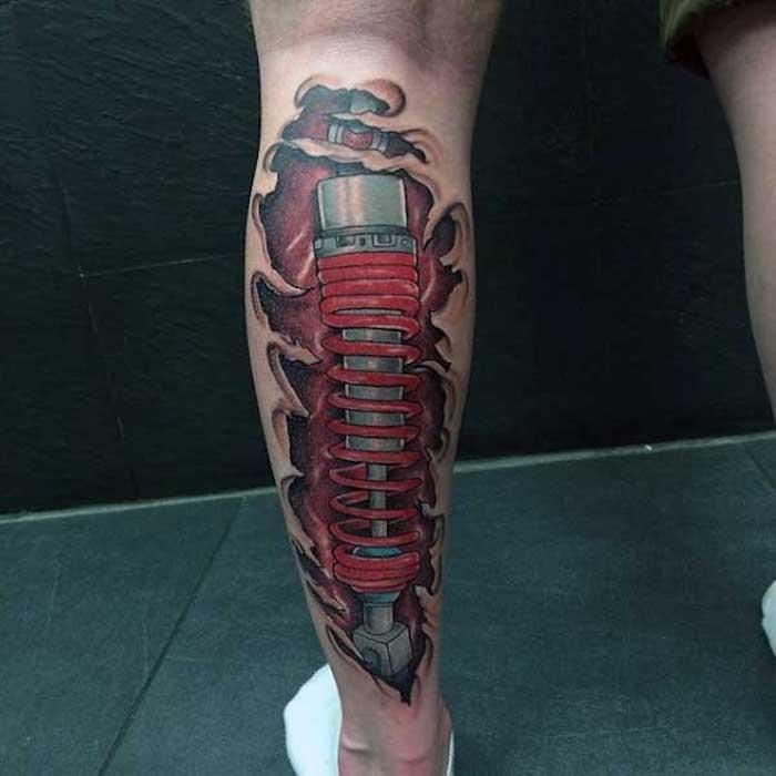 männer tattoos, frabige tätowierung am bein, roboter tattoo