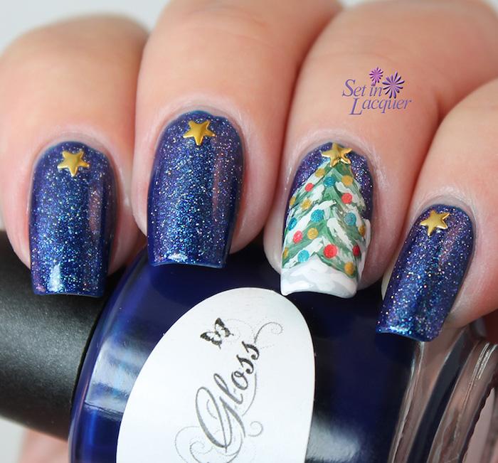weihnachtliche nägel blaues nageldesign sterne golden sekoration glitzer schnee