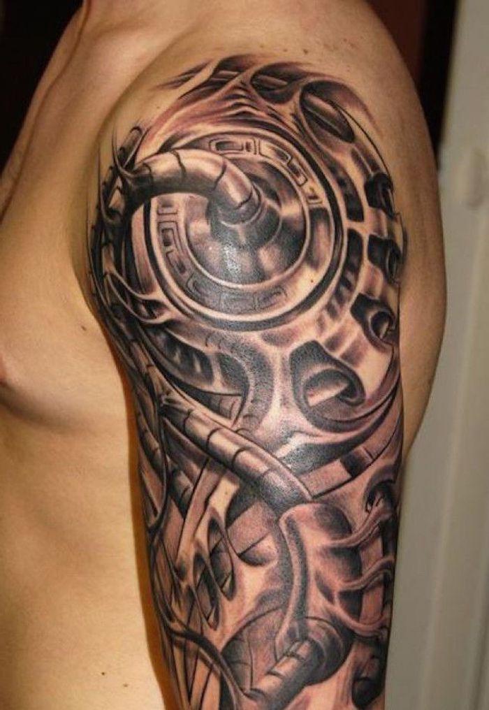 oberarm tattoo in schwarz und grau, biomechanische tätoierung