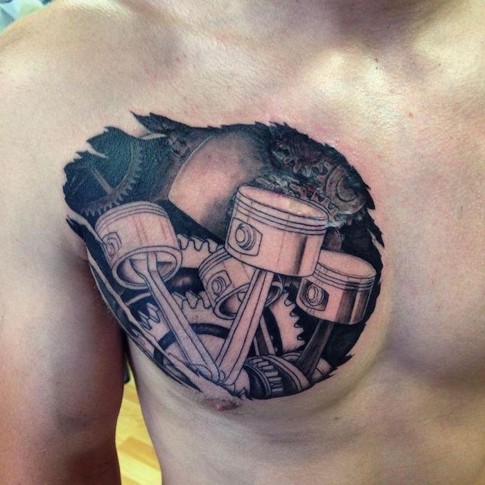 männer tattoos, mann mit schwarz-grauer tätowierung an der brust