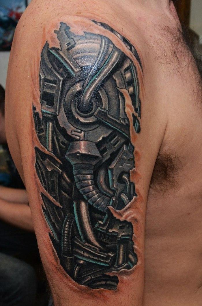 tattoos oberarm, schwarz-graue tätowierung im 3d-look am schulter, biomechanik tattoo oberarm