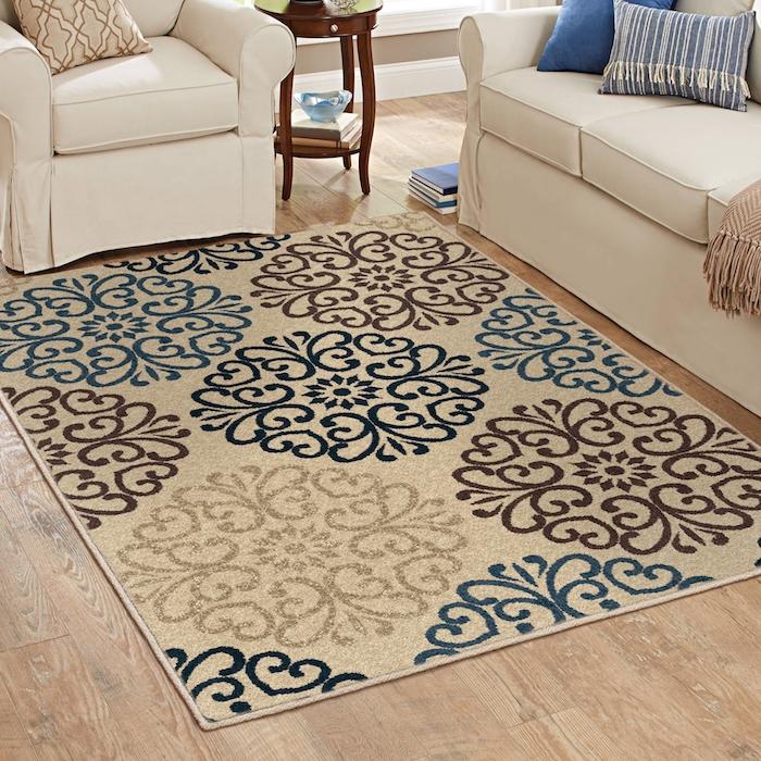 teppich türkis grau beige grundlage und bunte blumenförmige dekorationen schön
