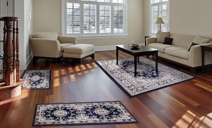 teppich gelb grau schwarz blau farben ideen sofa sessel kissen tisch wohnzimmer