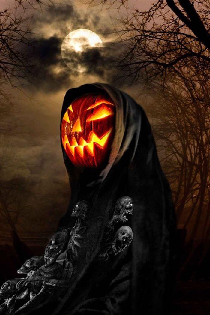 Bilder zu Halloween ein Kürbis Gesicht mit dem Vollmond im Hintergrund
