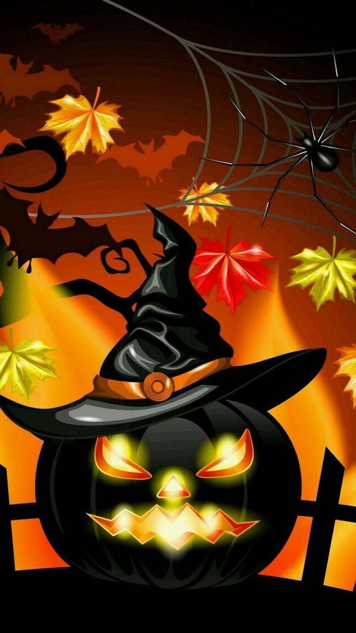 ein schwarzer Halloween Kürbis mit Hexenhut und kleine bunte Blätter darum
