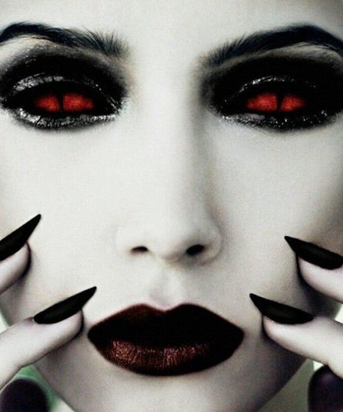 dünne dicke Augenbraun, gespitzte Nägel mit schwarzem Nagellack