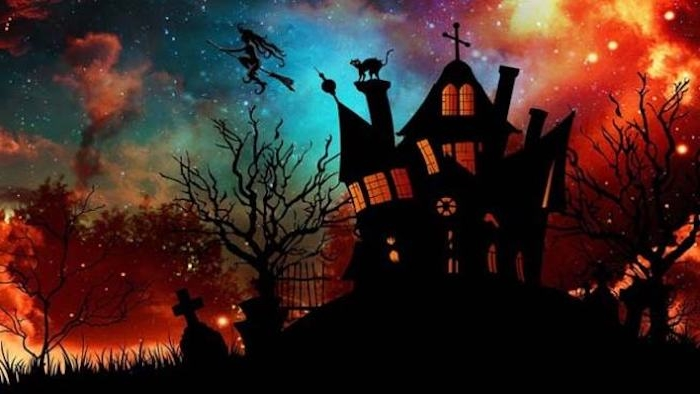 eine Kirche und eine Hexe die am Besen fliegt über den Friedhof - Bilder Halloween