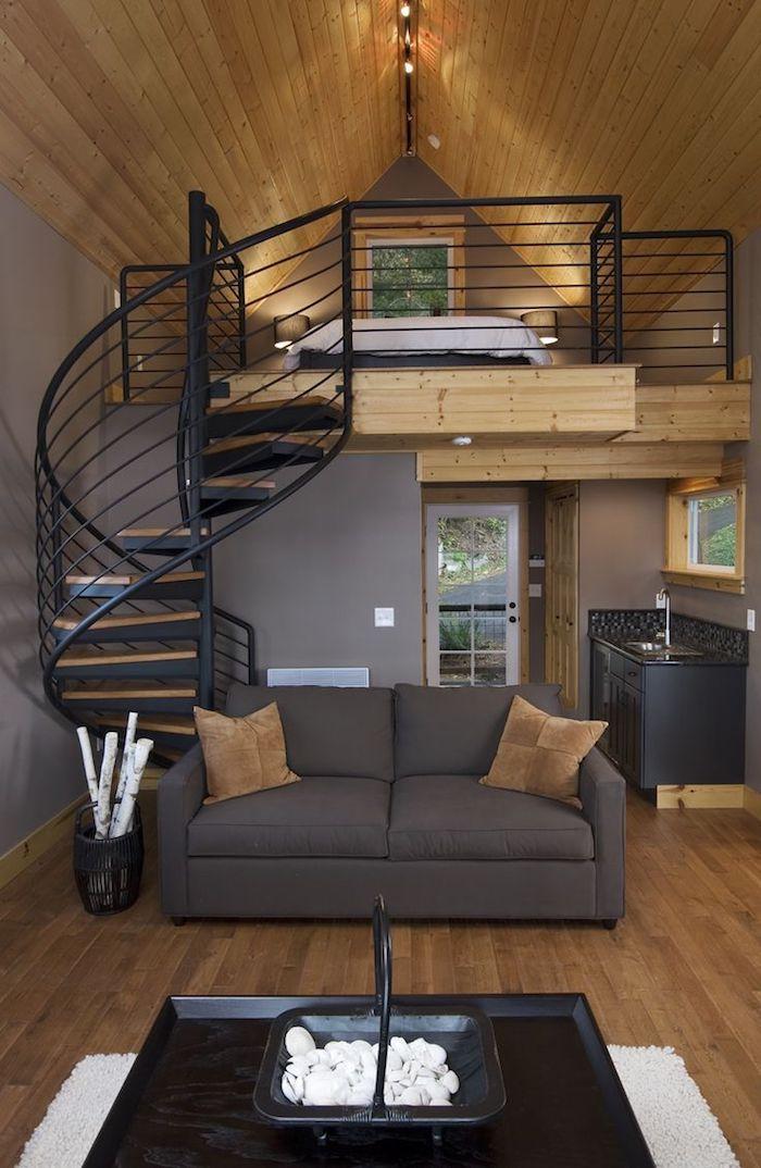 dachgeschosswohnung einrichten beispiele ideen sofa runde treppe leiter bett schlafzimmer