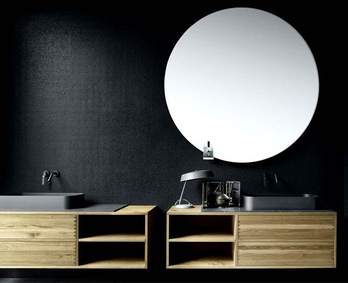 moderne bäder, großer runger spiegel, schwarze waschbecken mit unterschränken aus holz