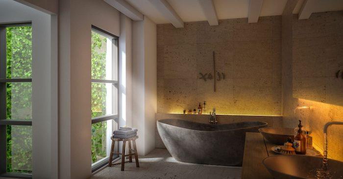 moderne badezimmer, graue freistehende badewanne aus naturstein, badezimmerbeleuchtung