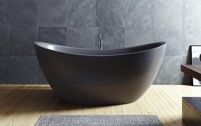 moderne bäder, graue natursteinfliesen, freistehende ovale badewanne