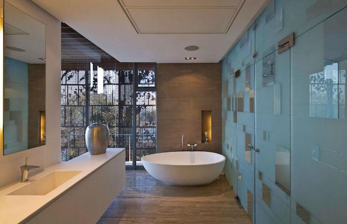 bad einrichten, ovale freistehende badewanne, moderne badezimmermöbel