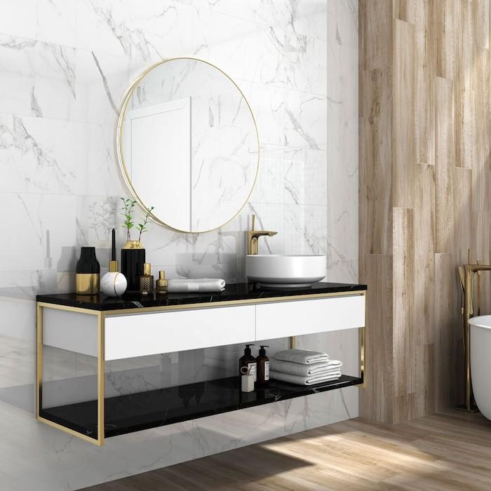 badezimmer deko, waschbecken mit unterschrank, runder spiegel mit goldenem rahmen