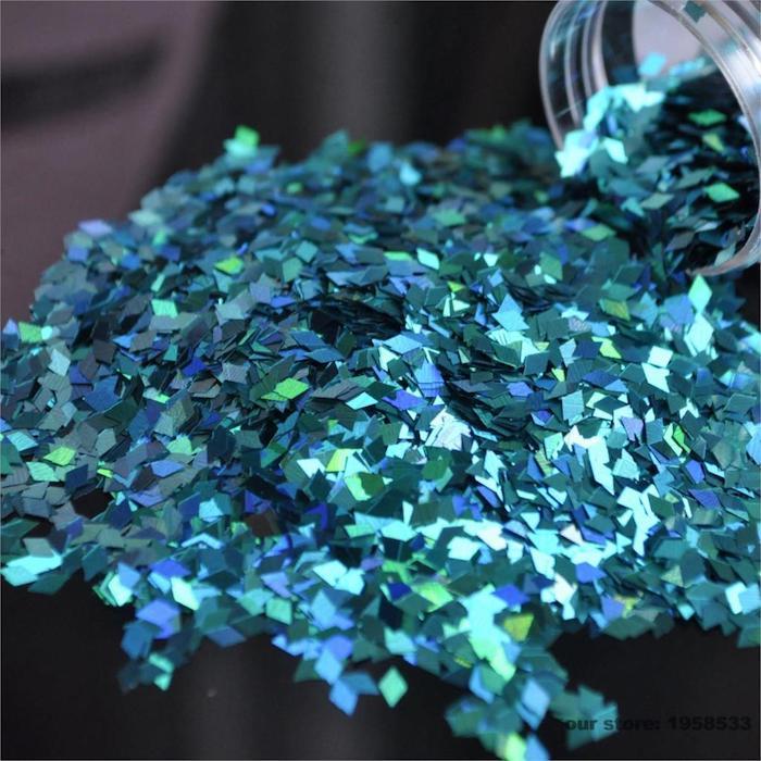 nageldesign glitzer elemente in verschiedenen formen größen und farben bunte deko für nägel farbenfrohe maniküre lustige laune