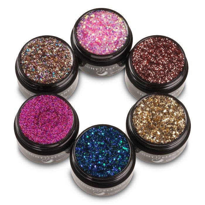 nailart bilder schöne glitzerfarben zum verzieren nagel dekorieren glänzender effekt blau rosa zyklame braun golden