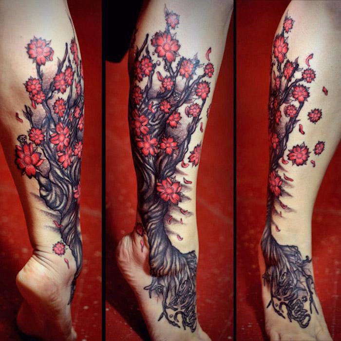 tattoo beudetung, baum mit roten blüten, tattoo mit kirschbaum-motiv am bein