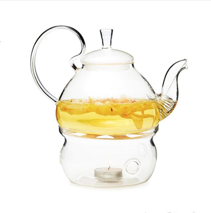 Teekanne mit Kerzewärmer mit schlichtem Design, ein rundes Loch im Glas, Teekanne aus Glas mit Kamillentee