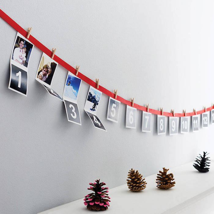 Adventskalender basteln für Männer - Nummer und Fotos hängen von einem roten Band