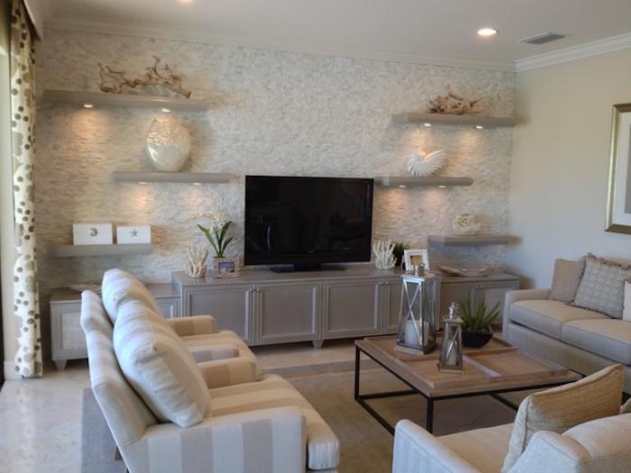 tv wand wohnideen wohnwand gestaltungsideen fernseher blumen sofa sessel großer fernseher