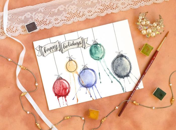 Aquarell Weihnachtskarte selbst gestalten, bunte Christbaumkugeln aufzeichnen, Frohe Weihnachten