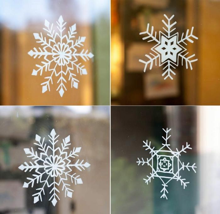 basteln schneeflocken kinder anleitung fensterdeko mit kindern machen schneeflocken schablone vier varianten weihnachtsdeko