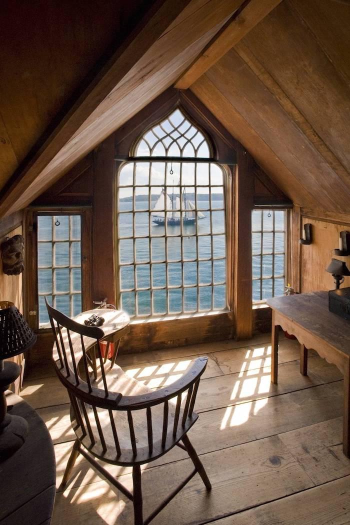 mansarde wohnung ideen schiff im meer stuhl in zimmer mansarde mit ausblick auf das meer holzhaus norwegien skandinavien fenster zum meer