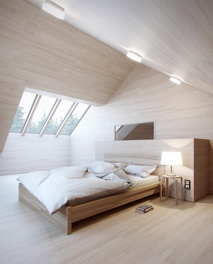 dachgeschosswohnung dezentes design der schlafzimmer bettdecke weiß stehlampe fenster mit aussicht buch auf dem boden weißes zimmer