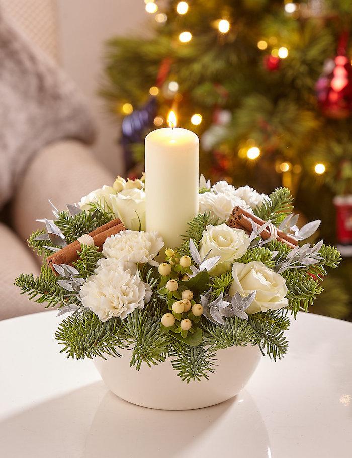 weihnachtsdeko selber machen weiße schüssel voll mit tollen deko elementen natur baumelemente kerze blumen