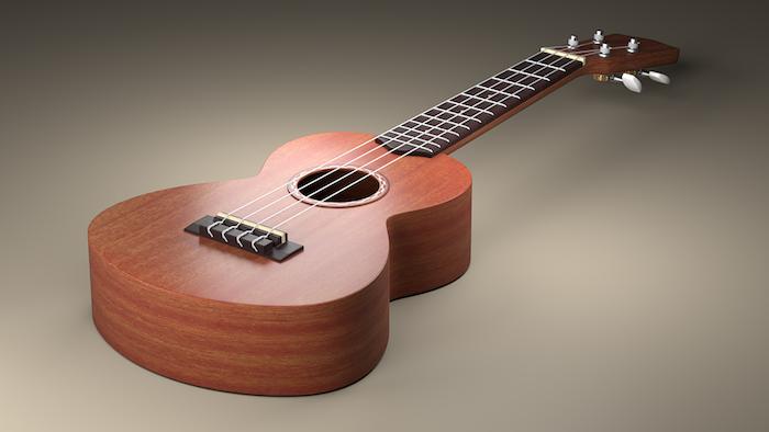 kleine dekorative akustische Gitarre mit vier Saiten aus Nylon, Hintergrund in den unterschiedlichen Nuancen von Grau