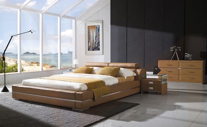 ein Haus mit Panorama, Doppelbett mit braunem Bettwäsche, ein grauer Teppich - schöne Zimmer