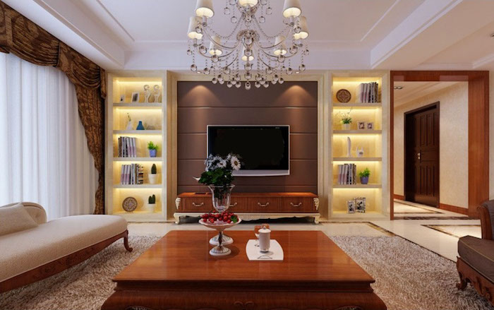 tv wandpaneel elegante lampe hängt vom dach wohndesign großer tisch sofa regale beleuchtung leuchtende regale bücher fernseher
