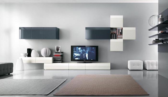 tv wandpaneel grau weiß und blau farben an der wand wandgestaltungsideen weiße regale schubladen deko