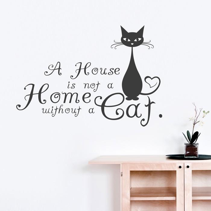 Wandtattoo - a house is not a home without a cat, ein Haus ohne Katze ist kein Heim, schwarze Katze mit langen schwarzen Schnurrbärten, Wohnung mit weißen Wänden, Holzschrank mit Glastüren mit kleinen runden schwarzen Griffen, weiße Orchidee in einem Glastopf, gestellt auf einem schwarzen ovalen Tablett