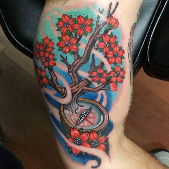 symbol für stärke, kirschbraum mit roten blüten in kombination mit kompass