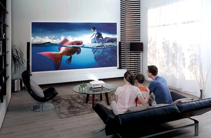 moderne wohnwand zeit für die familie zusammen fernsehen und dann die filme kommentieren und analysieren mama papa und kind