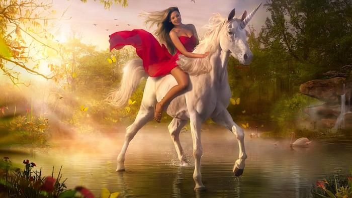 eine junge frau mit einem roten kleid - ein wildes weißes einhorn mit einer dichten mähne